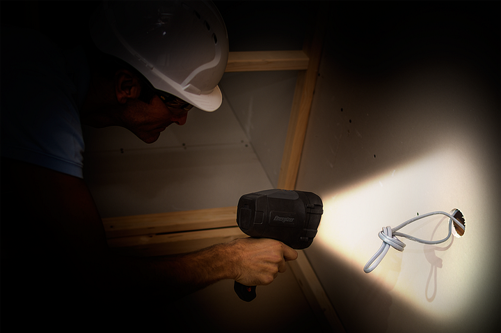 a man checking cables in the dark with the Energizer HardCase Spotlight