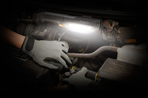 a man checking the car engine with the Energizer HardCase Professional Work Area Light