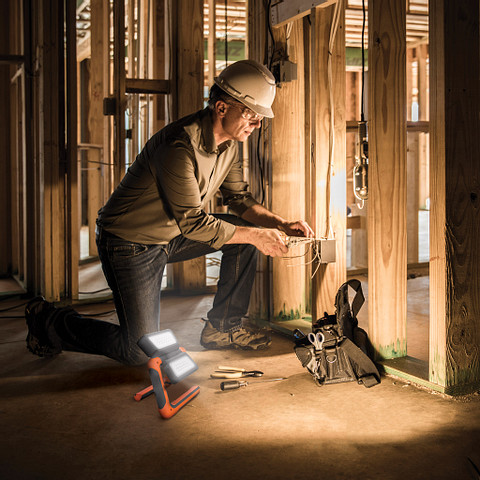 a man fixing electric cables by the light of the Energizer Rechargeable Panel Work Area Light