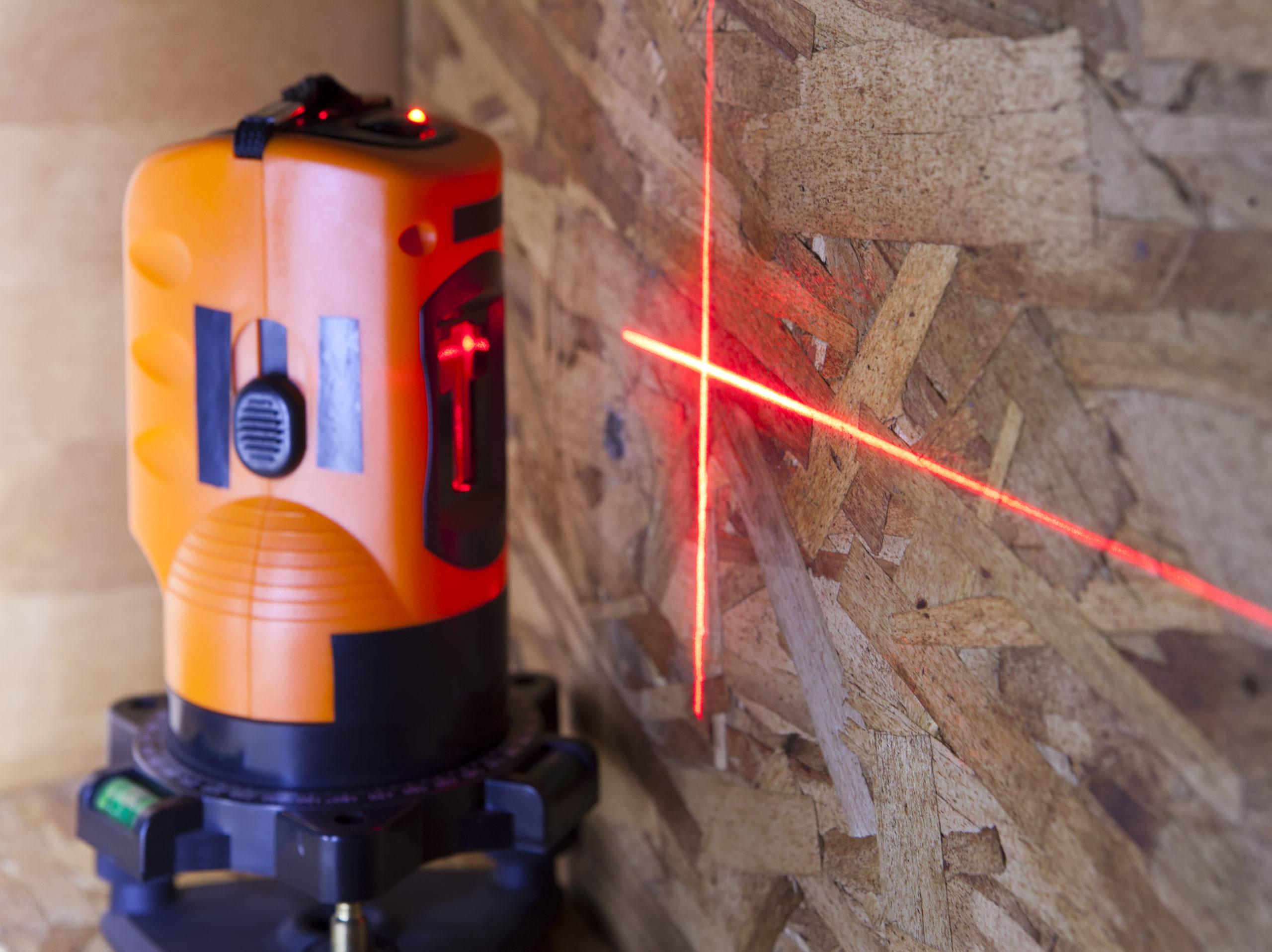 an orange laser measurement level for construction