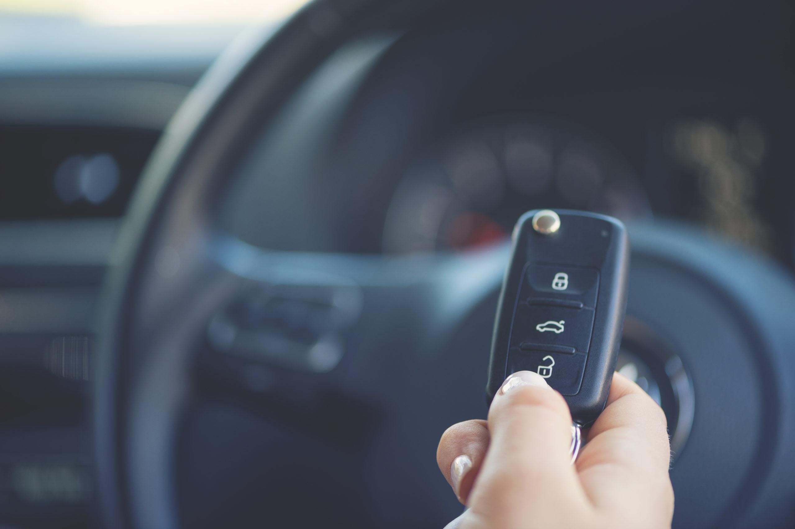 a woman holding a car keyfob