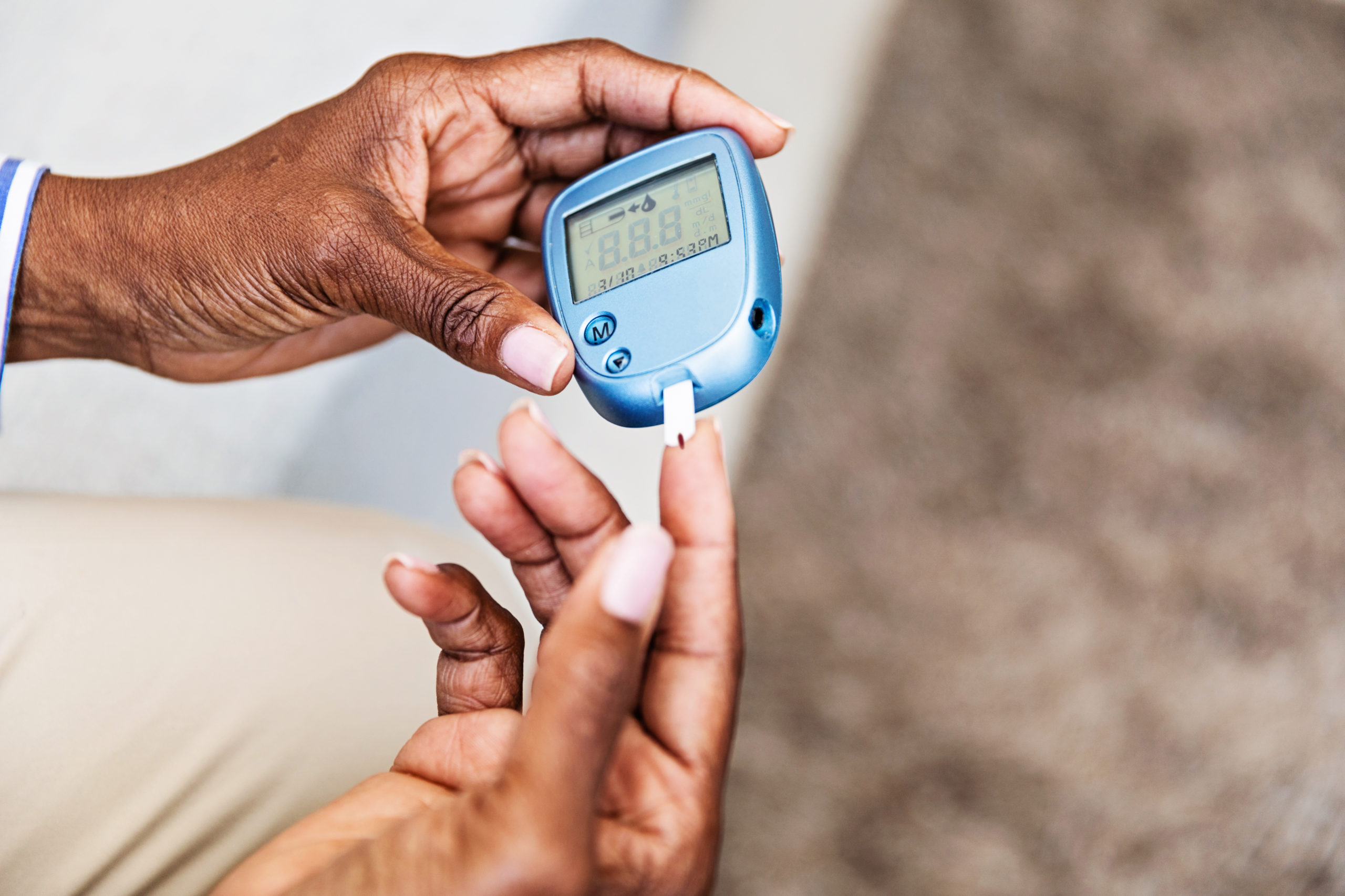woman with diabetes checking her blood sugar